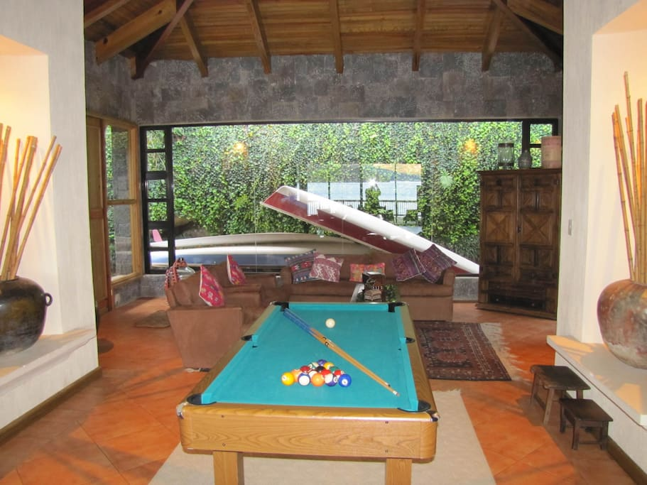 Small pool table in one of the 3 living rooms.
