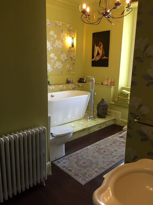 The shared bathroom with a bath and shower cubicle