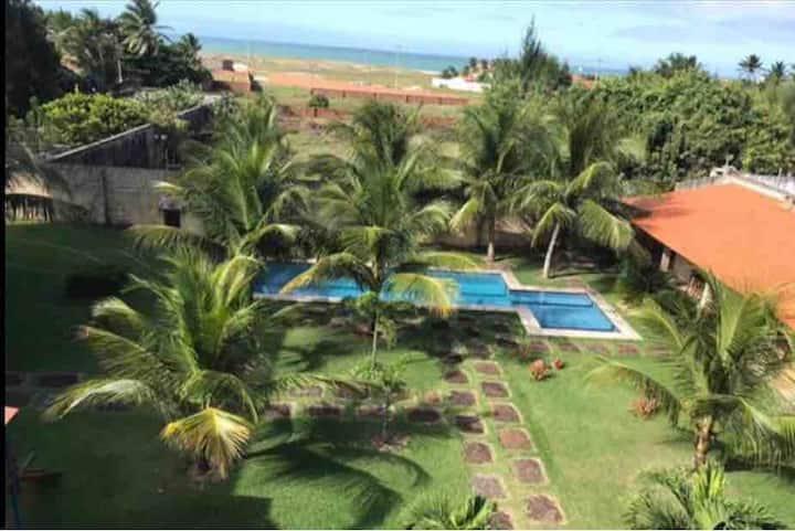 Apart. com vista p o mar, piscina,deck,playground.