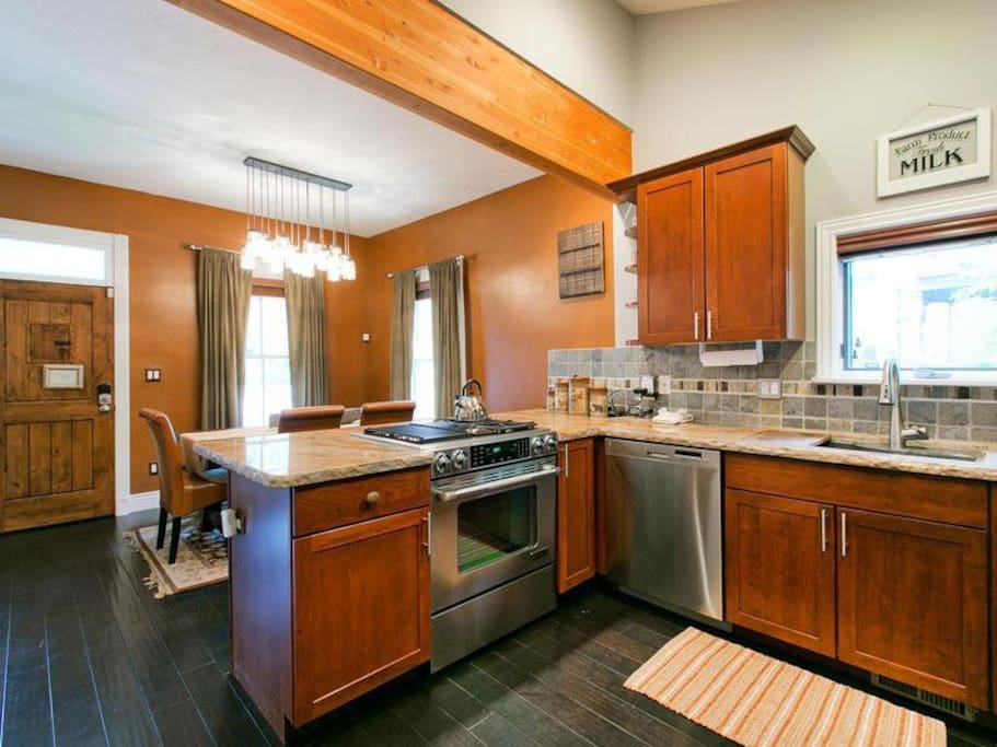 kitchen with cherry cabinets, wood floors, stainless steel appliances