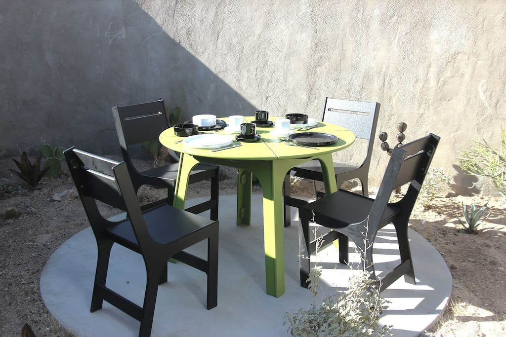 Enclosed front patio for outdoor dining.