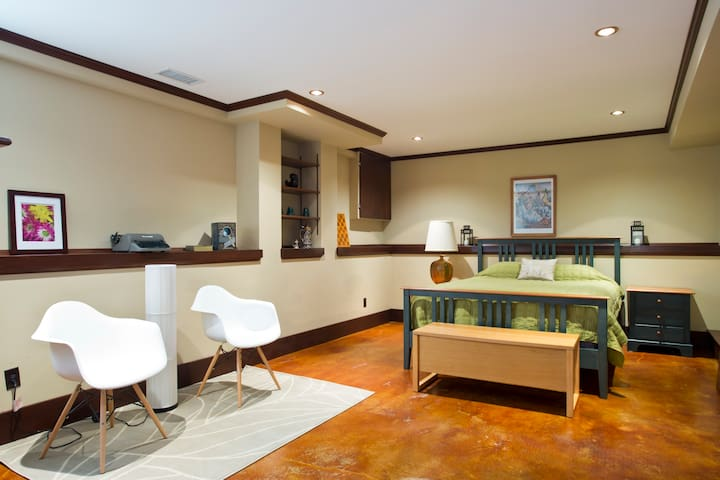 Spacious master bedroom.  Polished concrete floors throughout.