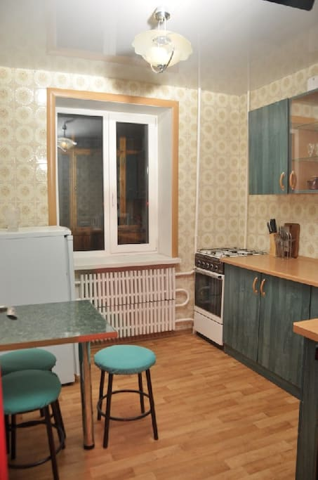 The spacious kitchen has a dining table