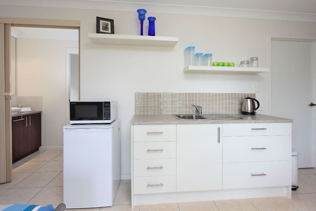 Kitchenette with fridge, microwave, kettle and  toaster.  Basic cereals, tea and coffee provided.