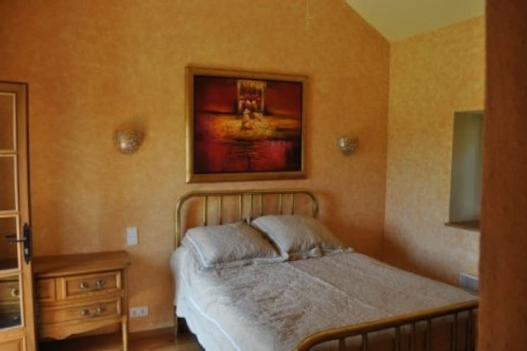 The master bedroom with a lovely comfortable double bed