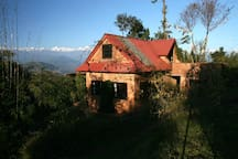 Himalayan Retreat cottage, private, quiet, secluded in 10 acre peach farm. Enjoy the front and back porches- perfect for yoga, reading, musing or meals. Loft, boncos, skylight, kitchen, furnished with bedding, pots and pans, solar lights, modern toilet, c
