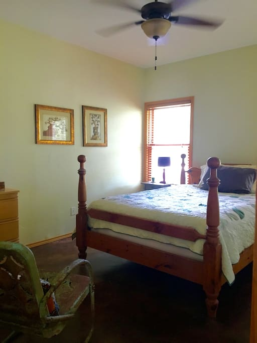 Comfortable queen bed with plenty of room for unpacking and settling in.