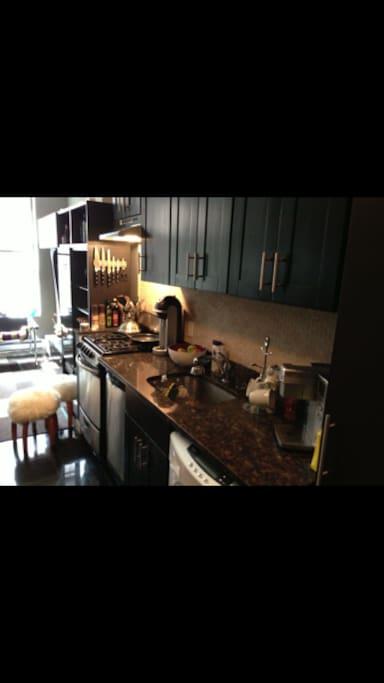 Kitchen with brand new stove, dishwasher and washer/dryer machine