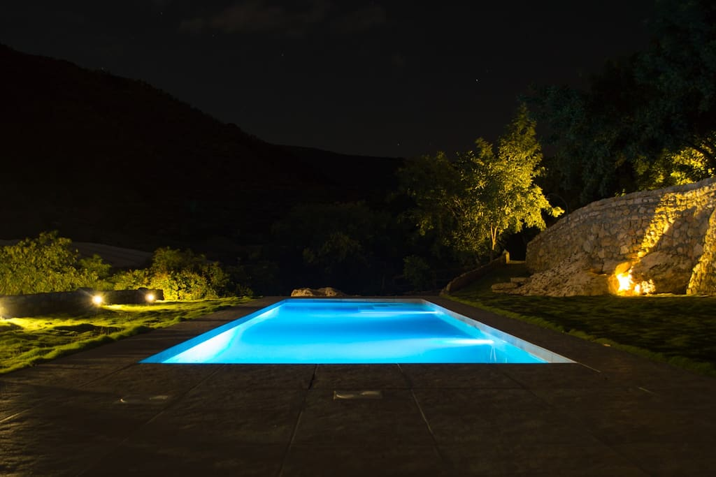 Swimming pool at night. The colors of the pool can be changed.