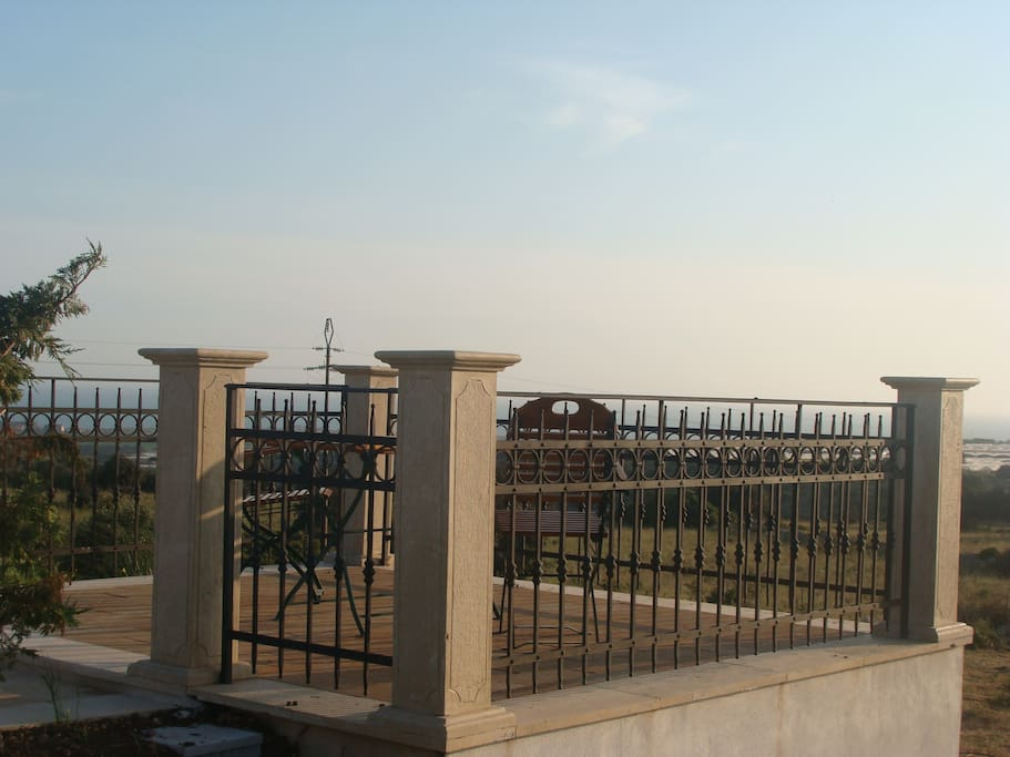 A terrace with view over the sea