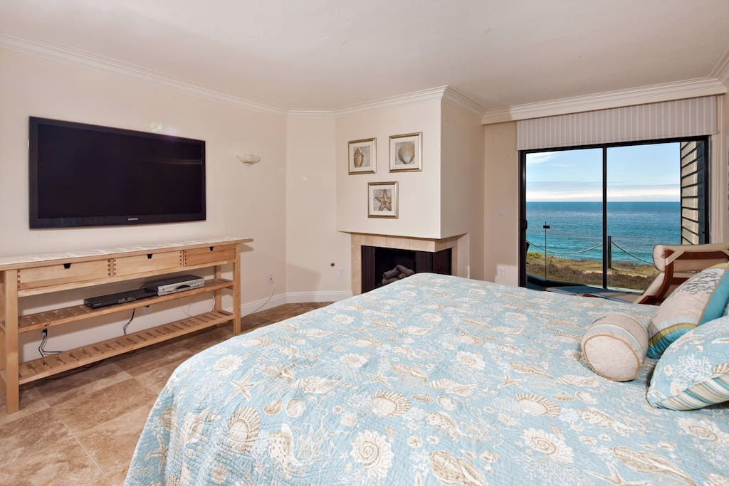 King size bed, ocean view, and patio access from Master