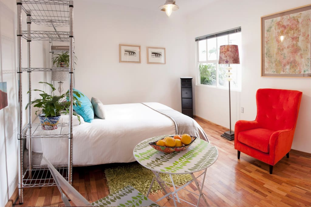 Bright colors  and hardwood floor make a cozy space to live