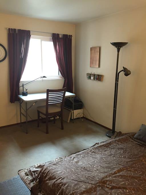 Bedroom: Queen Bed, desk, window