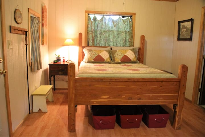 Handmade cedar queen bed.
