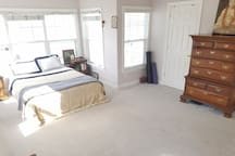 Large master suite with vaulted ceilings. Room for yoga, exercise, and more