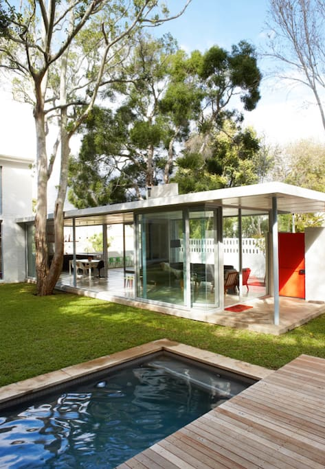 Exterior of house with glass living area