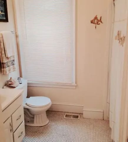 Get freshened up in the full bathroom upstairs. (the grout is actually in pretty good shape, this picture doesn't do it justice).