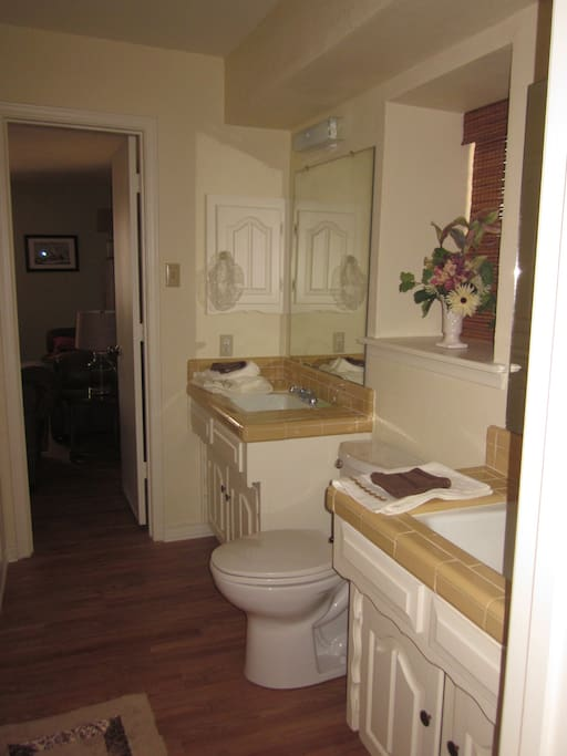 You have plenty of space to prepare yourself in this attached Jack & Jill bath with two lavatories & roomy walk-in shower.