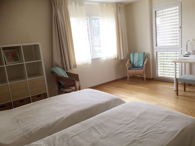 Twin bedroom with private facilities