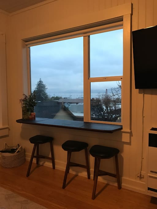 Walnut Bar with 3 stools. Gorgeous views of bay to watch the boats and sunset or sunrise.