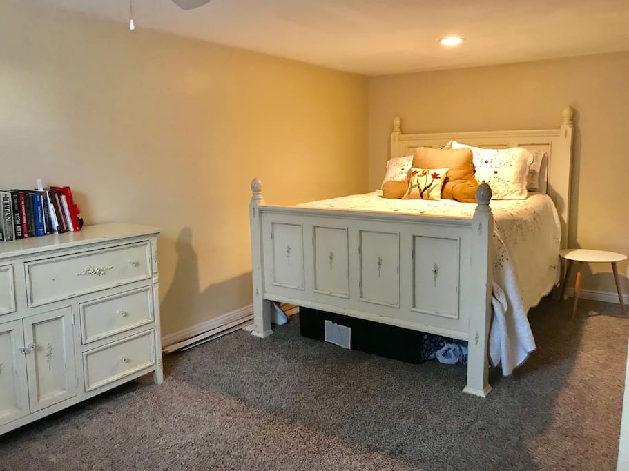 Large bedroom with two dressers, nightstand, full closet, and--most importantly--a queen sized bed.