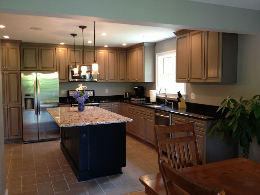 Gourmet kitchen with granite countertops, stainless steel appliances and Keurig coffee