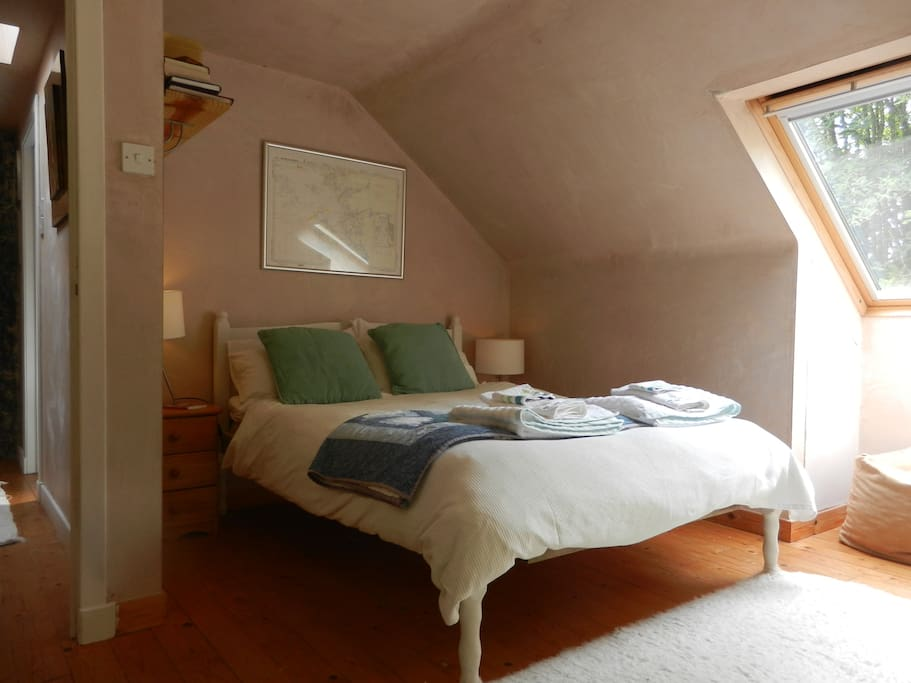 The double bed, with the window looking west over the garden.