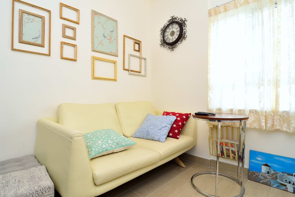 Sofa area with frame decoration, side tables and stools