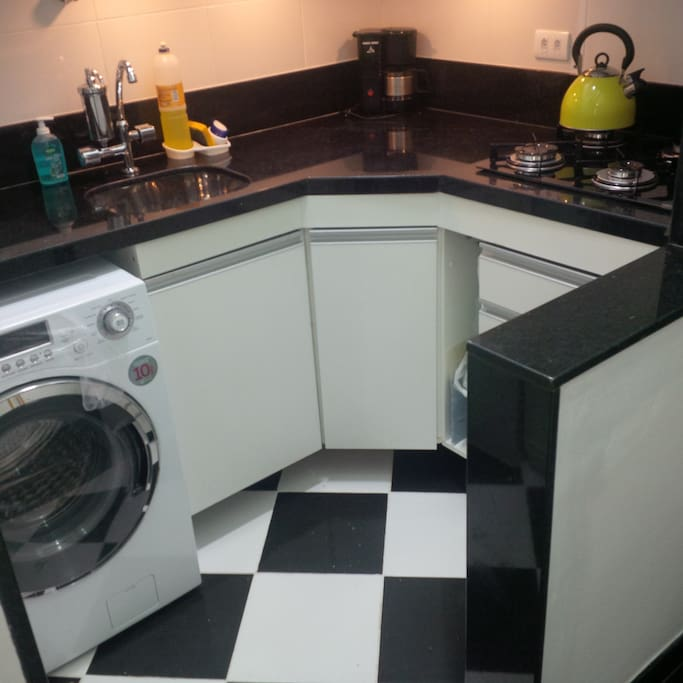 Modern Kitchen with Cooktop, Microwave, Kettle, Toaster and Washing Machine