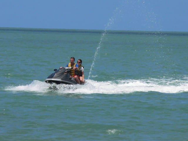 Fantastic Jet skiing on clear aqua water, brilliant.