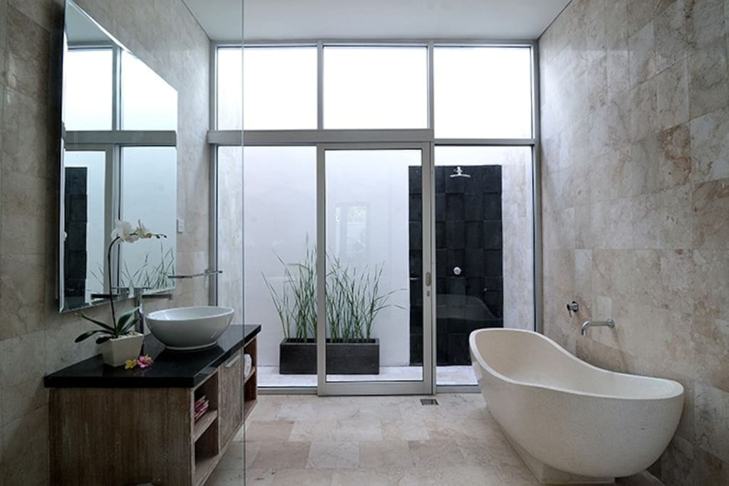 Ensuite complete with outdoor and indoor shower.