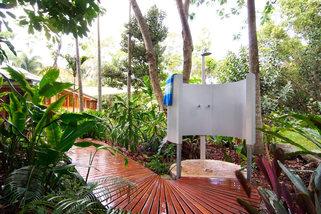 Private outdoor shower with rainforest views