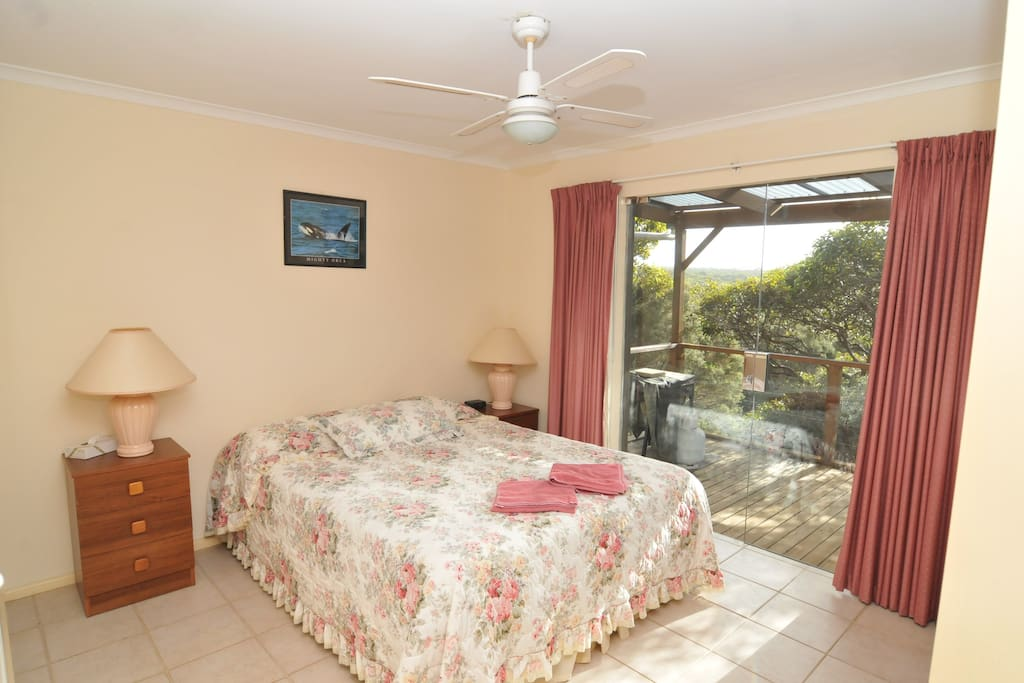 Queen size bedroom - large windows so you can enjoy views of the natural vegetation and Harriet River.