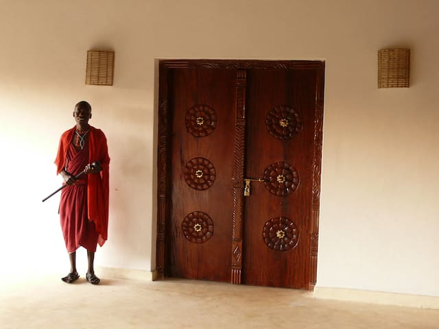 Swahili door into bedroom 4 and David one of our staff