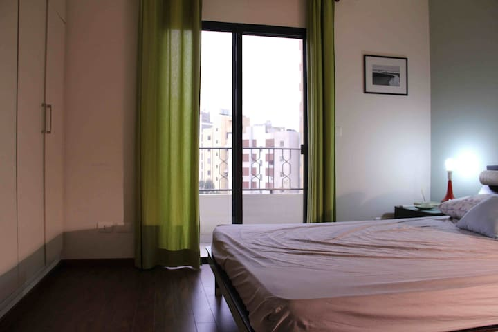 room overlooking the main road. the sliding door with double layer glass to cut outside noise.