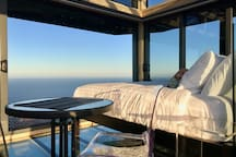 Soak in the sea views from the comfort of bed