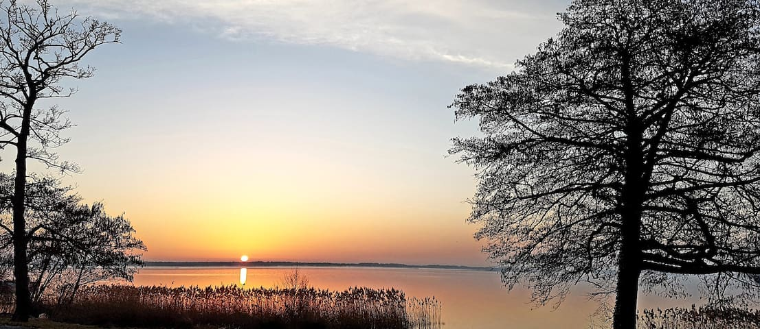 Enjoy the sunrise over the nearby lake