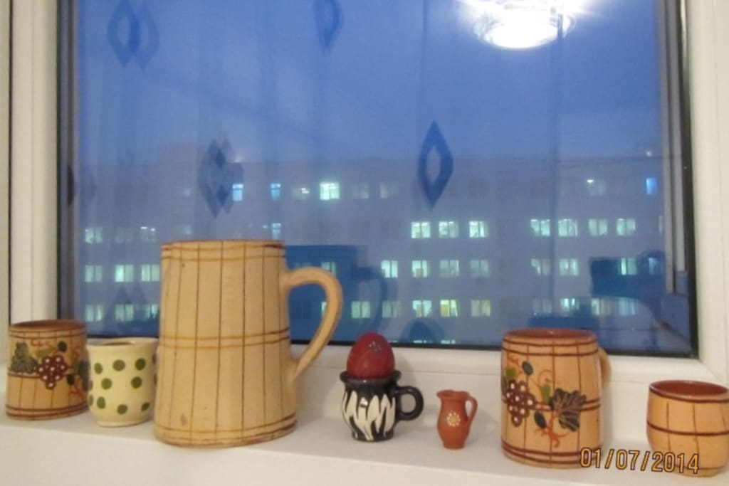 Detail from the window of the room, with traditional hand made clay cups and jug you can use