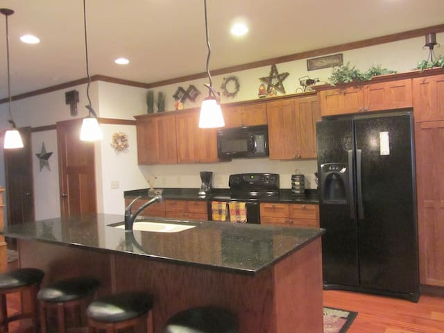 Fully stocked kitchen for all your cooking needs. Snack bar seating for 4