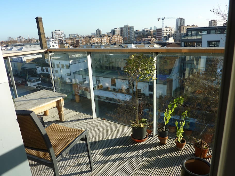 Balcony views over South East London Shoreditch.. Canary wharf Tower.. The balcony gets sun from dawn thru the afternoon.