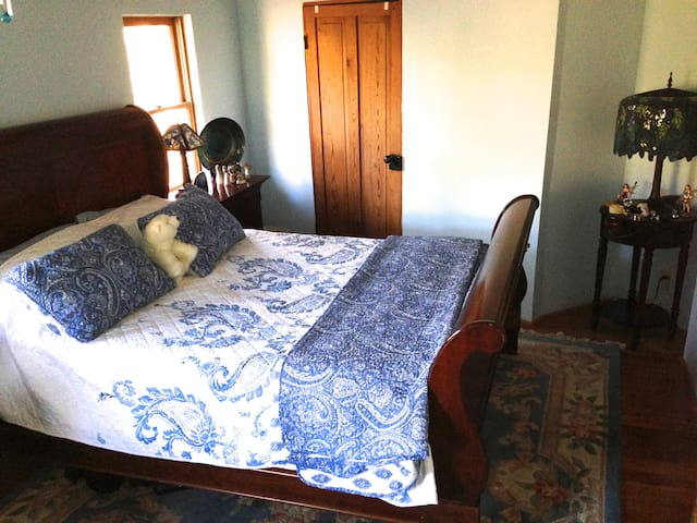 Upstairs Blue Bedroom - queen bed & extra long couch