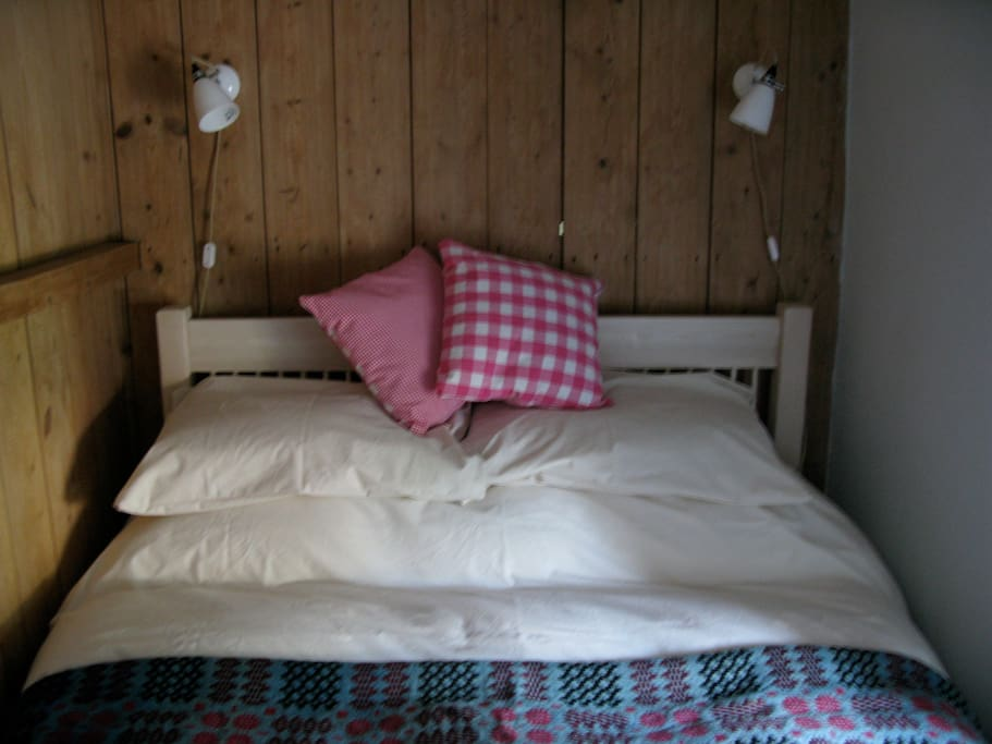 Main bedroom with double bed and Welsh Carthen.