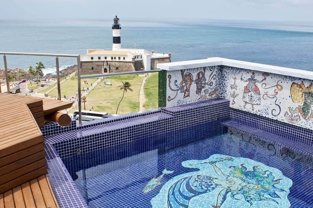 Pool, mosaics of orixás, view of Farol