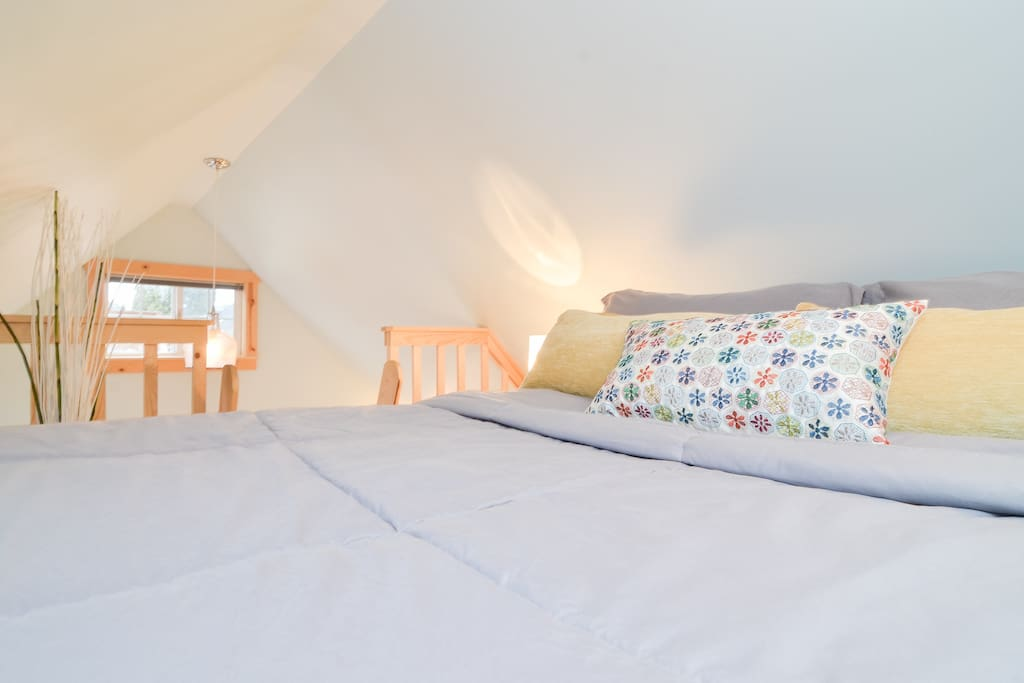 Double bed in loft space.