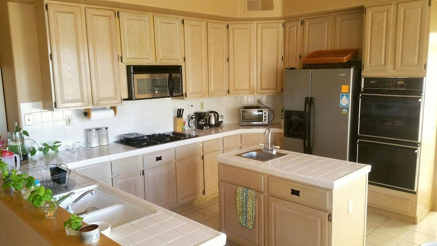 Full kitchen to whip up your favorite meal or maybe bake a dessert. Silverware, cooking supplies, fridge, caninets & pantry space provided.