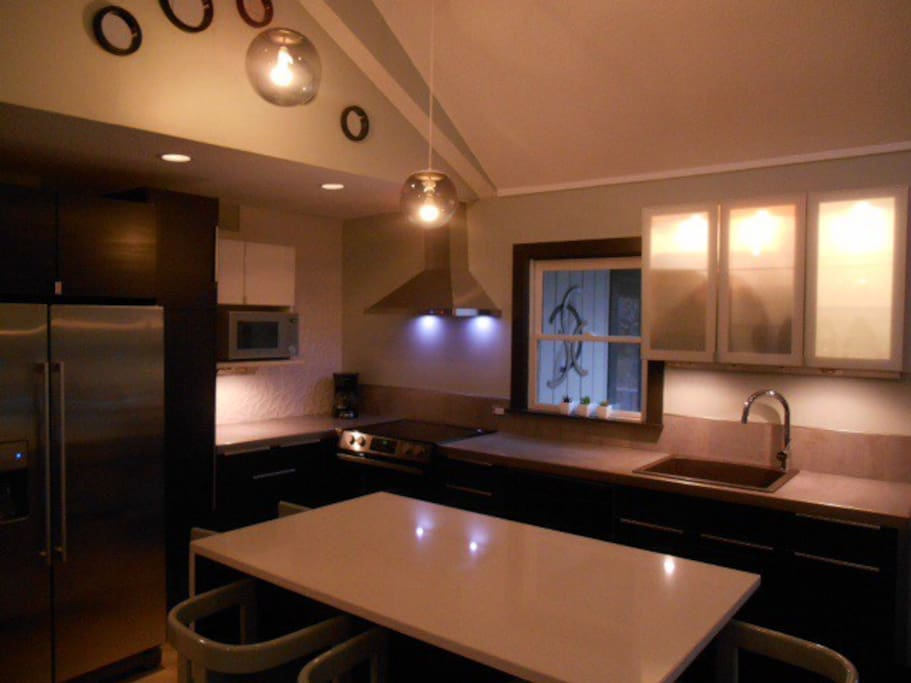 Newly remodeled kitchen with new appliances, dishes, cutlery, cookware--everything you need for an intimate dinner or small gathering.