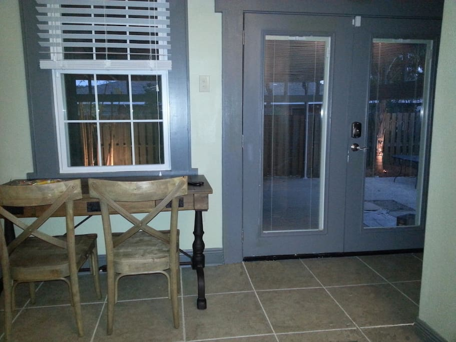 Night view of dining area to outdoor patio