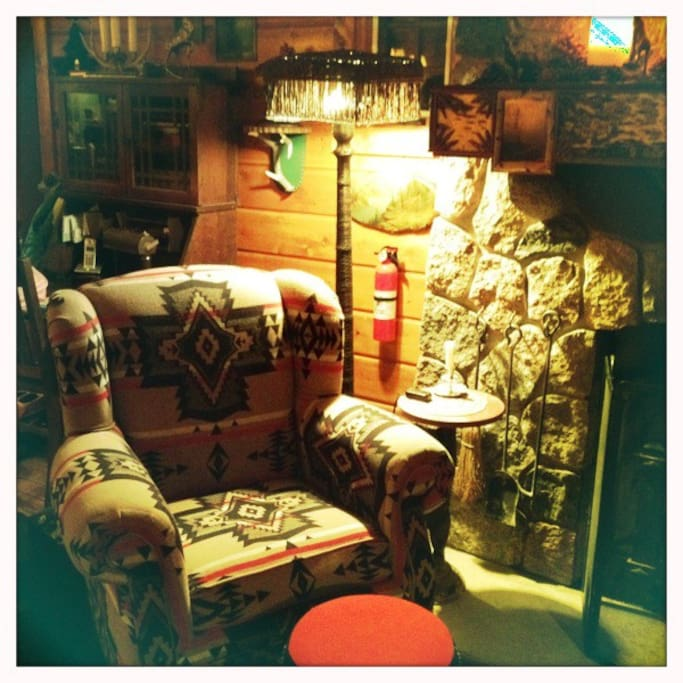Wonderful reading chair by the stone fireplace!