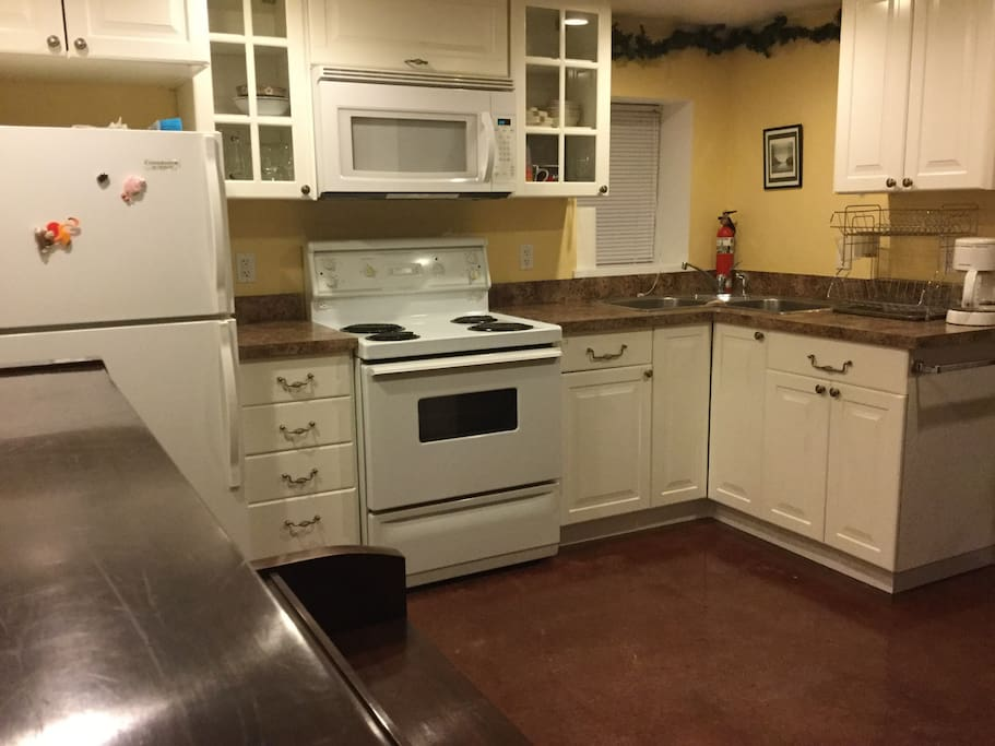 Full kitchen with full size fridge, stove and microwave