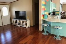 """55"""" TV with Direct TV   2 Stools at Kitchen Counter"""